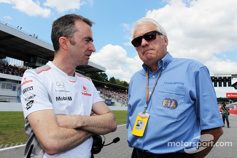 Paddy Lowe, McLaren Technical Director with Charlie Whiting, FIA Delegate on the grid