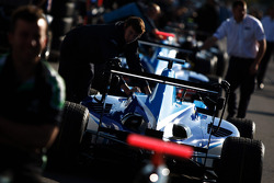 The cars are being pushed into the pit lane