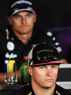 Kimi Raikkonen, Lotus F1 Team and Heikki Kovalainen, Caterham in the FIA Press Conference
