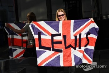 A Lewis Hamilton, McLaren fan with supportive Union Jack flag