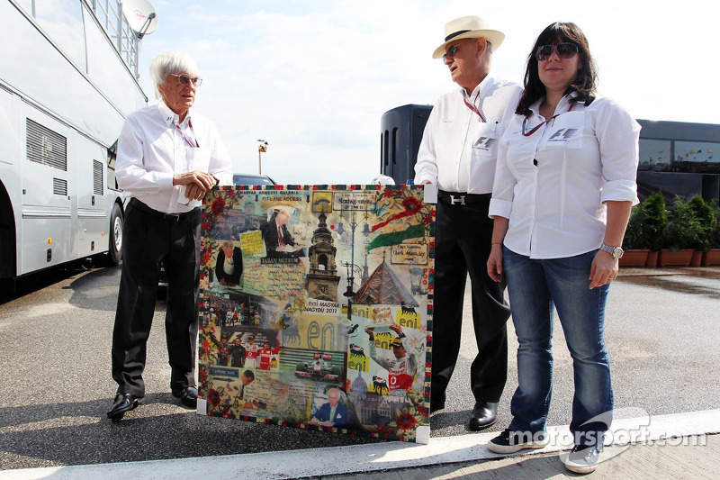 Bernie Ecclestone, CEO Formula One Group, Hungarian GP Promoter and the daughter of Tamas Frank, with a Hungarian Grand Prix montage by artist Mark Dickens