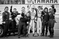 Race winners Daisuke Ito and Kazuya Oshima celebrate