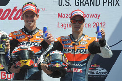 Podium: race winner Casey Stoner, Repsol Honda Team, third place Dani Pedrosa, Repsol Honda Team