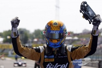 Race winner Esteban Gutierrez celebrates