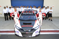 Gabriele Tarquini and Tiago Monteiro pose with the Honda Civic and the team