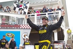 Victory lane: winner Marcos Ambrose celebrates