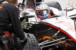 Jenson Button, McLaren practices a pit stop