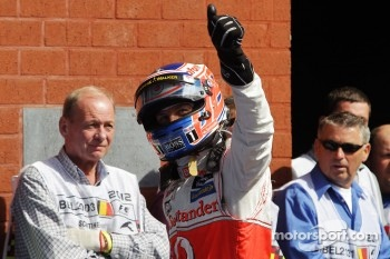 Jenson Button, McLaren celebrates his pole position in parc ferme