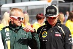 Heikki Kovalainen, Caterham with Kimi Raikkonen, Lotus F1 Team on the drivers parade