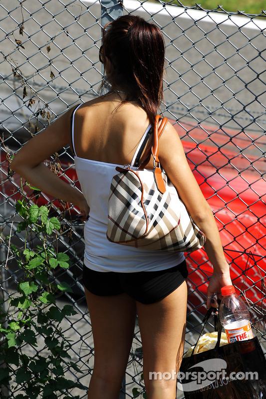 A fan watches a Ferrari pass