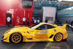 The Ferrari 512 leaves the paddock