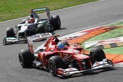 Fernando Alonso, Ferrari leads Michael Schumacher, Mercedes AMG F1