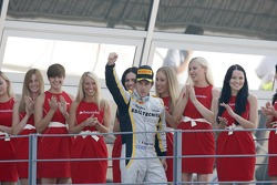 Race winner Davide Valsecchi celebrates