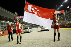 Grid girls with Singapore flag