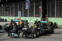 Nico Rosberg, Mercedes AMG F1 and team mate Michael Schumacher, Mercedes AMG F1 batlte for position