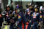 Scuderia Toro Rosso mechanics await a pit stop