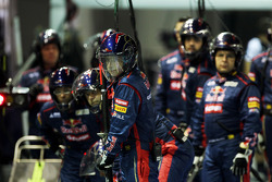 Scuderia Toro Rosso mechanics await a pit stop
