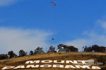 The special Bathurst livery for Team Vodafone is delivered to the track via helicopter