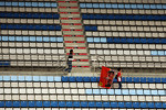 A lone Ferrari fan in the grandstand