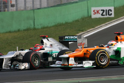 Paul di Resta, Sahara Force India Formula One Team and Michael Schumacher, Mercedes GP