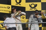 Podium: Charly Lamm, team manager BMW Team Schnitzer gets sprayed with champagned by Bruno Spengler, BMW Team Schnitzer BMW M3 DTM
