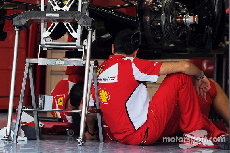 Ferrari F2012 is prepared by mechanics in the pits