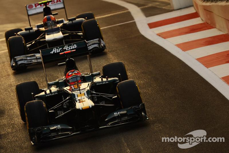Heikki Kovalainen, Caterham leads Bruno Senna, Williams out of the pits