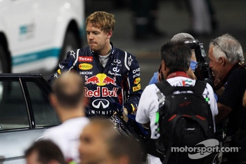 Sebastian Vettel, Red Bull Racing is escorted back to parc ferme