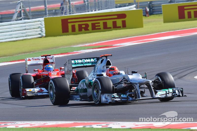 Michael Schumacher, Mercedes AMG F1 leads Fernando Alonso, Ferrari