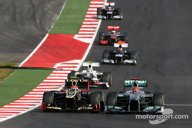 Romain Grosjean, Lotus F1 Team and Michael Schumacher, Mercedes GP