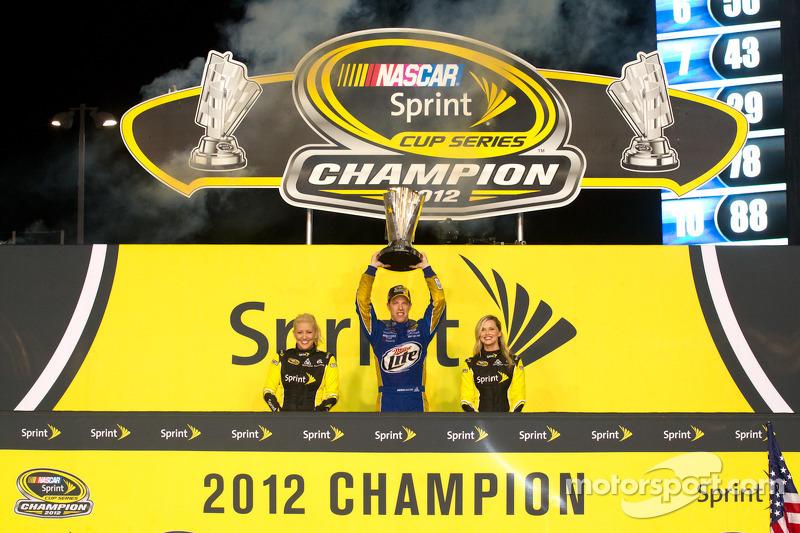 Championship victory lane: 2012 NASCAR Sprint Cup Series champion Brad Keselowski, Penske Racing Dodge celebrates with the Miss Sprint Cup girls