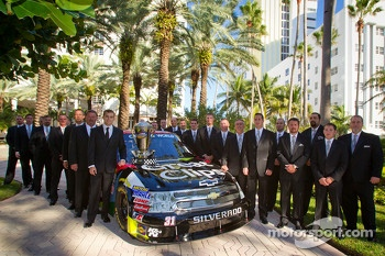 NASCAR Camping World Truck Series champion driver James Buescher, Turner Motorsports Chevrolet poses with his team