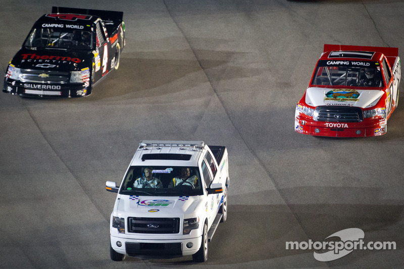 Pace truck leads Parker Kligerman, Red Horse Racing Toyota and Kyle Larson, Earnhardt Ganassi Racing Chevrolet to pace laps