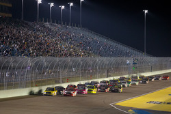 Restart: Kyle Busch, Kyle Busch Motorsports Toyota and Parker Kligerman, Red Horse Racing Toyota lead the field