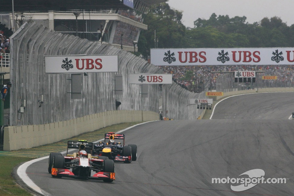 Narain Karthikeyan, HRT Formula One Team HRT leads Sebastian Vettel, Red Bull Racing