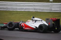 Lewis Hamilton, McLaren retired from the race after crashing with Nico Hulkenberg, Sahara Force India F1