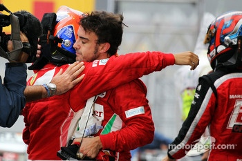 Fernando Alonso, Ferrari and Felipe Massa, Ferrari console each other in parc ferme