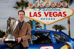 Brad Keselowski in front of the Las Vegas sign