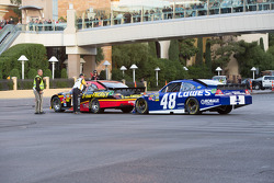 Clint Bowyer's car is pushed by Jimmie Johnson after a problem