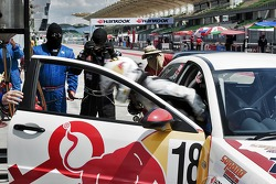 Siti Zirwatul exits Red Bull Rookies' car 18 during a driver changeover.
