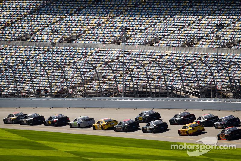 Martin Truex Jr., Michael Waltrip Racing Toyota leads a group of cars