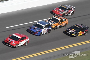 A group of Continental Tire Sports Car Series cars practice on track