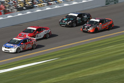 A group of cars race on track
