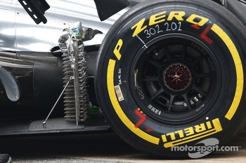 McLaren MP4-28 running sensor equipment at the rear suspension