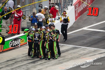 Stewart-Haas Racing Chevrolet crew members confer before the race