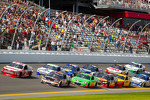 Trevor Bayne, Wood Brothers Racing Ford and Denny Hamlin, Joe Gibbs Racing Toyota battle for the lead