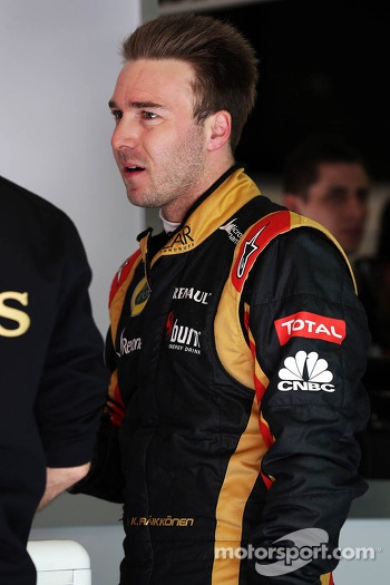 Davide Valsecchi, Lotus F1 Third Driver literally standing in the overalls of the unwell Kimi Raikkonen, Lotus F1 Team