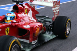 Fernando Alonso, Ferrari F138 running flow-vis paint at th exhaust and rear suspension
