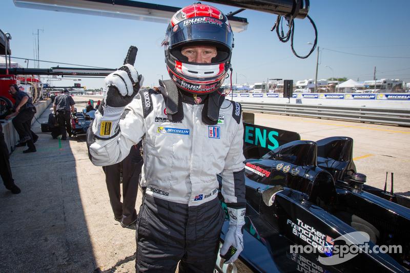 P2 pole winner Ryan Briscoe celebrates
