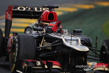 Race winner Kimi Raikkonen, Lotus F1 E21 celebrates at the end of the race